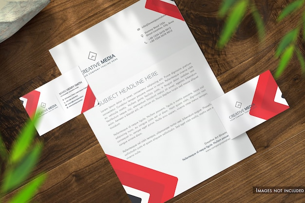 Letterhead and business cards on wooden desk top view mockup