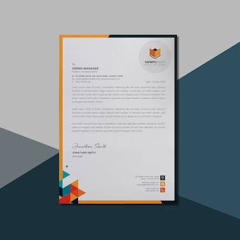 Letterhead layout with orange geometric shape