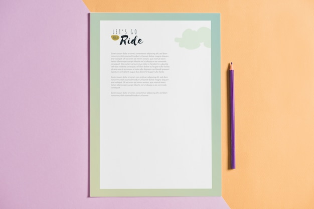 Letterhead mockup next to pen