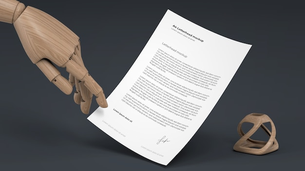 Letterhead mockup with wooden puppet hand