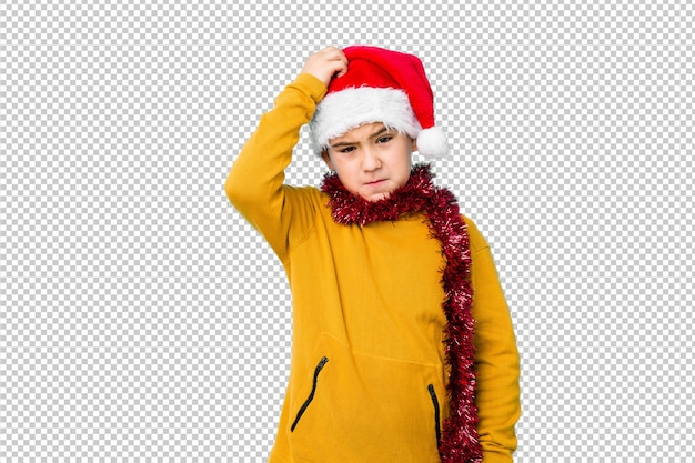 Little boy celebrating christmas day wearing a santa hat isolated being shocked, she has remembered important meeting.