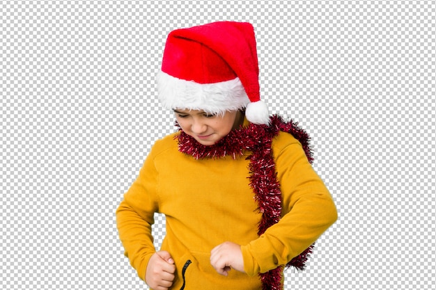 Little boy celebrating christmas day wearing a santa hat isolated dancing and having fun.
