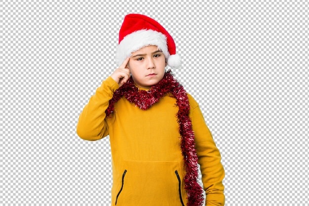 Little boy celebrating christmas day wearing a santa hat isolated pointing temple with finger, thinking, focused on a task.