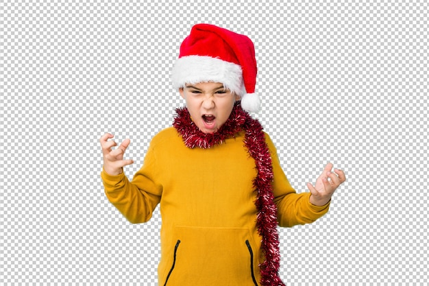 Little boy celebrating christmas day wearing a santa hat isolated screaming with rage.