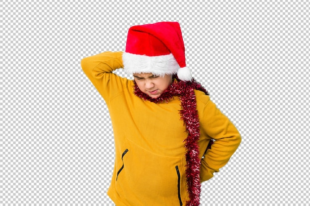 Little boy celebrating christmas day wearing a santa hat isolated suffering neck pain due to sedentary lifestyle.
