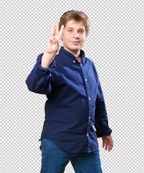Little boy gesturing number three