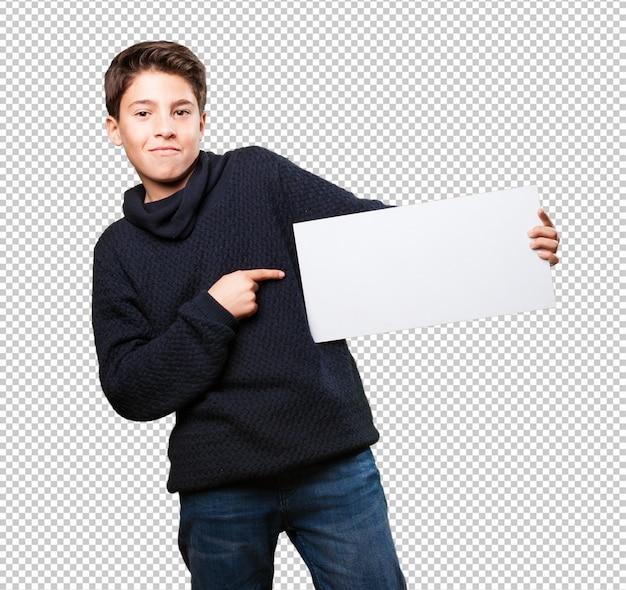 Little boy holding a banner