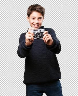 Little boy holding a camera