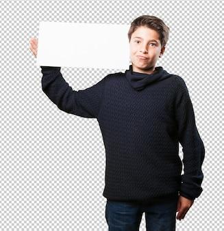 Little boy holding a placard