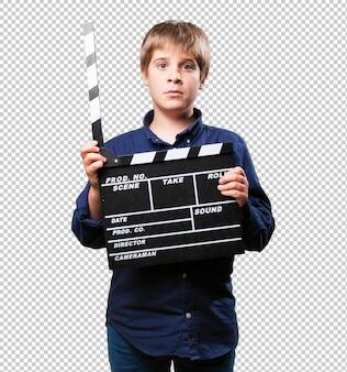 Маленький мальчик с колотушкой