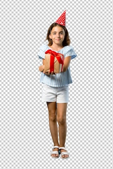 Little girl at a birthday party holding a gift keeping arms crossed