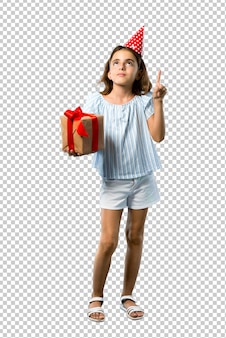 Little girl at a birthday party holding a gift standing and thinking an idea