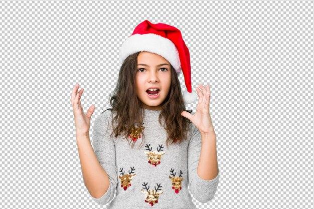 勝利または成功を祝うクリスマスの日を祝う少女、彼は驚いてショックを受けた。