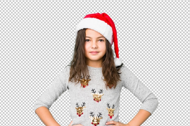 Little girl celebrating christmas day confident keeping hands on hips.
