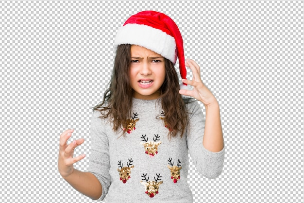 Little girl celebrating christmas day screaming with rage.