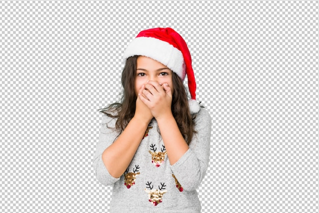 Little girl celebrating christmas day shocked covering mouth with hands.
