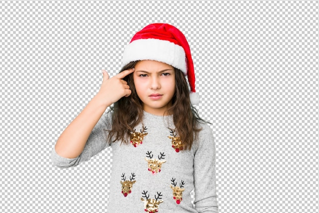 Little girl celebrating christmas day showing a disappointment gesture with forefinger.