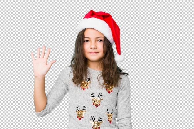 손가락으로 명랑 보여주는 숫자 5 웃 고 크리스마스를 축 하하는 어린 소녀.