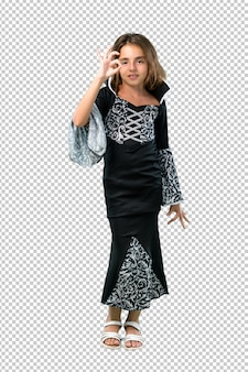 Little girl dressed as a vampire for halloween holidays showing an ok sign with fingers