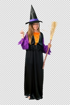 Little girl dressed as a witch for halloween holidays counting number one sign
