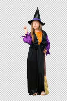 Little girl dressed as a witch for halloween holidays pointing with the index finger a great idea