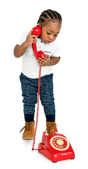 Little girl red telephone concept