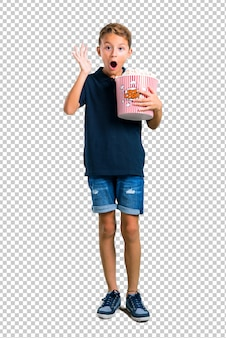 Little kid eating popcorns