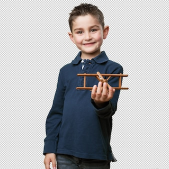 Little kid holding an airplane toy