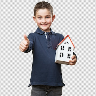 Little kid holding a house