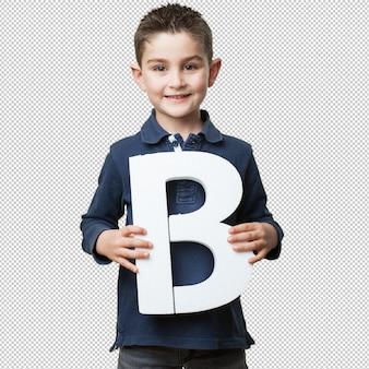Little kid holding the b letter