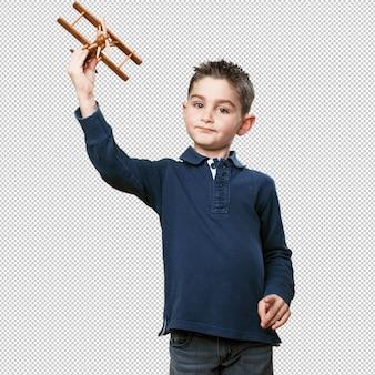복엽 비행기를 가지고 노는 작은 아이