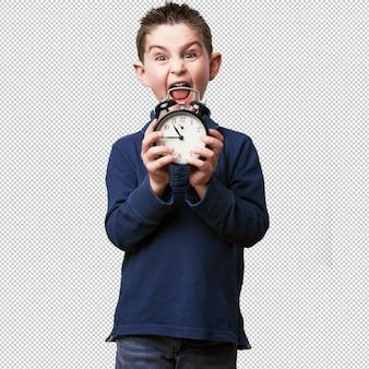 Little kid with an alarm-clock