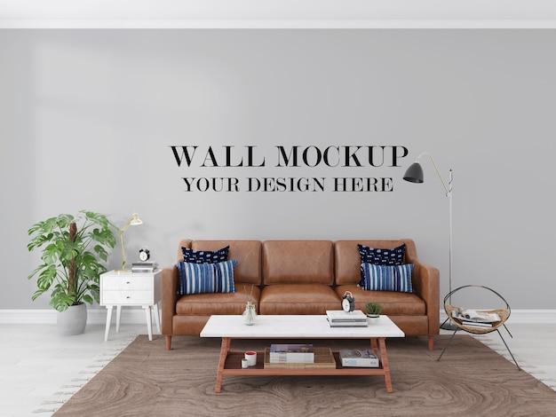革のソファの後ろのリビングルームの空の壁3dレンダリングモックアップ