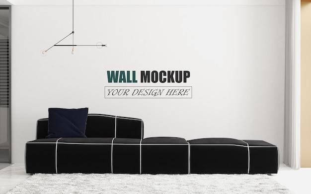В гостиной есть макет стены черного дивана