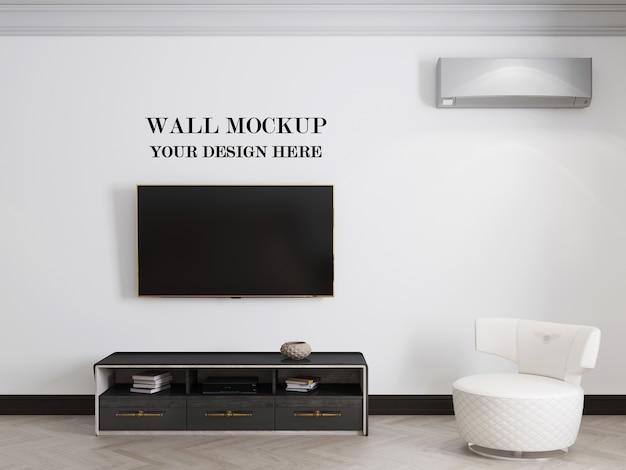 テレビとキャビネットとリビングルームの壁の背景のモックアップ