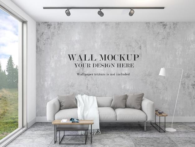 Living room wall mockup behind modern sofa