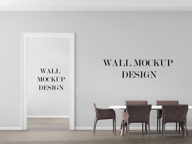 テーブルと革張りの椅子のあるリビングルームの壁のモックアップ