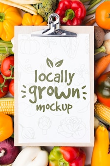 Locally grown veggies mock-up on clipboard