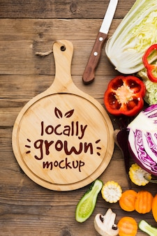 Locally grown veggies mock-up and cutting board