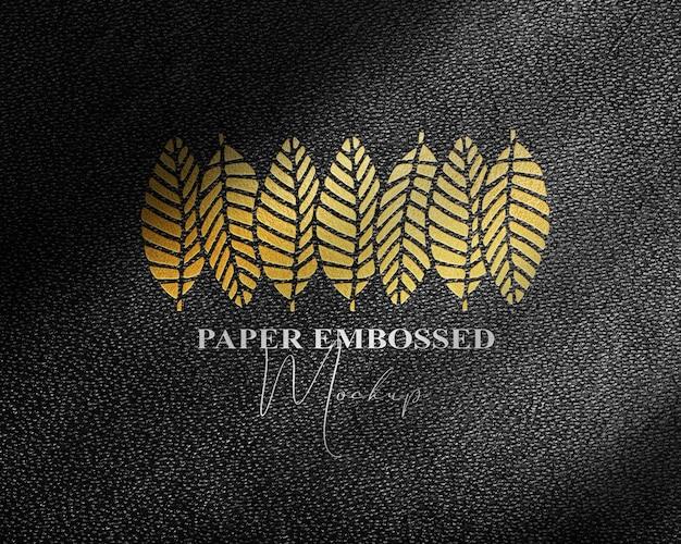 Logo embossed mockup with black leather background