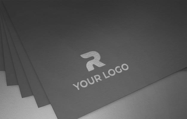 Логотип золотая фольга на текстурированной черной бумаге макет шаблона
