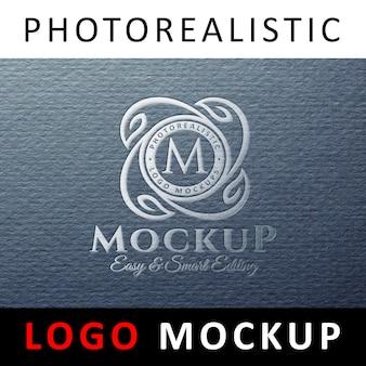 ロゴモックアップ - 青色の灰色の紙にシルバーホイルスタンピングロゴ