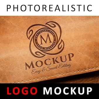 Logo mock up-오래된 가죽에 새겨진 로고가 새겨 져 있습니다.