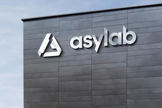 ロゴモックアップ3dモダンな建物のサイン