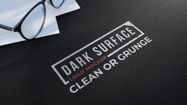 Logo mockup on a black fabric surface