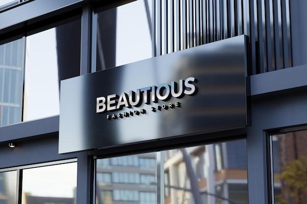Logo mockup on black facade store sign