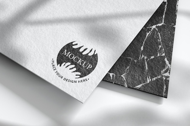 Logo mockup on business card with overlay shadow Premium Psd