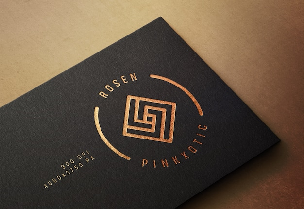 Logo mockup on business card with pressed gold print effect