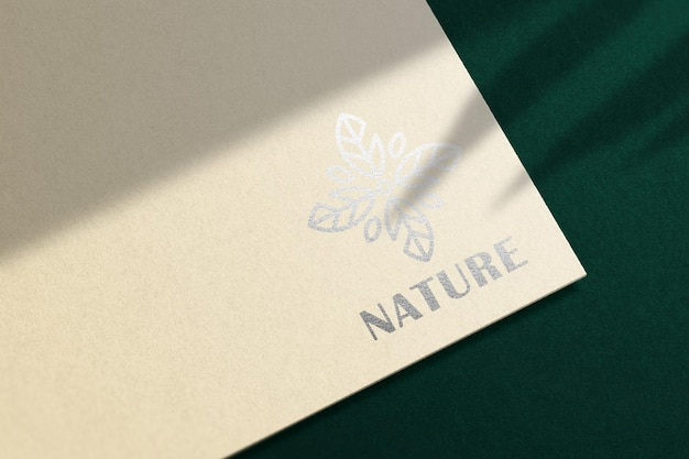 Logo mockup on cream paper with silver foil