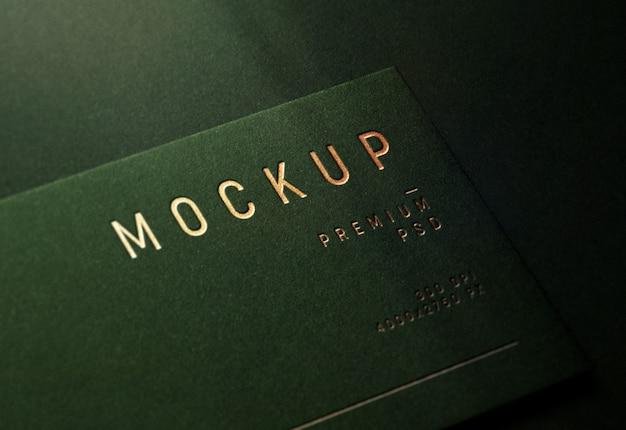 Logo mockup on dark olive business card
